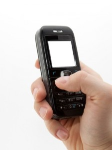 mobile phone in hand by sqback at stock.xchng